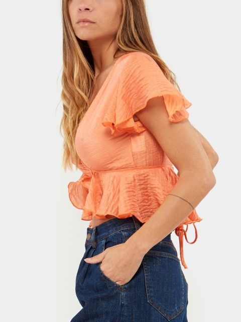 TOP WITH RUFFLE AND CHEST STRAP